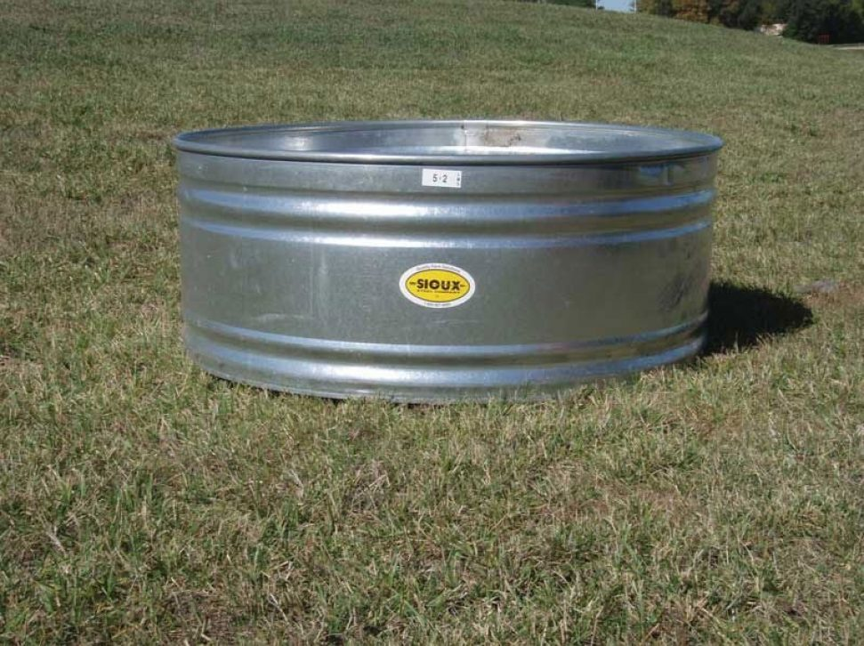 Round Stock Tank, in a pasture